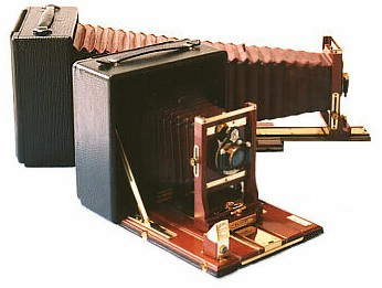 A pair of 5x7 cameras with one fully extended.