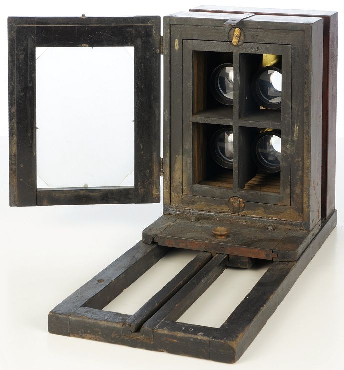 Rear view of Bon Ton View Box showing the collion staining and mask to produce four images on a single ferrotype plate.